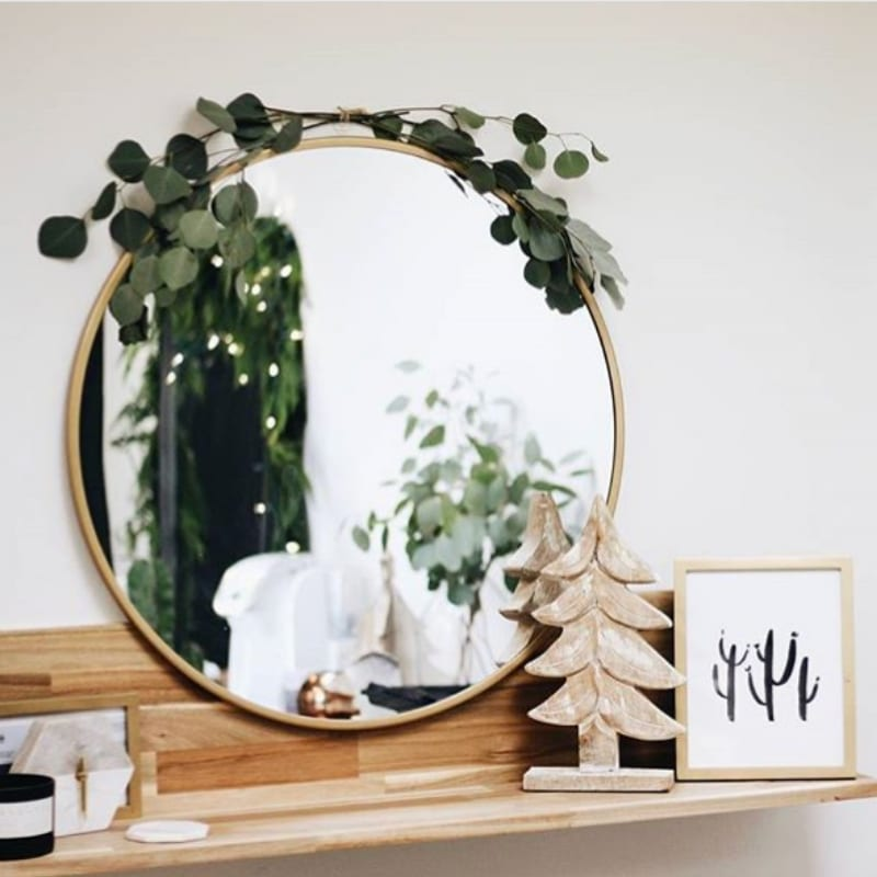 Minimalist Christmas Decorations by Jamie Dana Hairstylist mirror decorated with eucalyptus branches and wooden Christmas tree