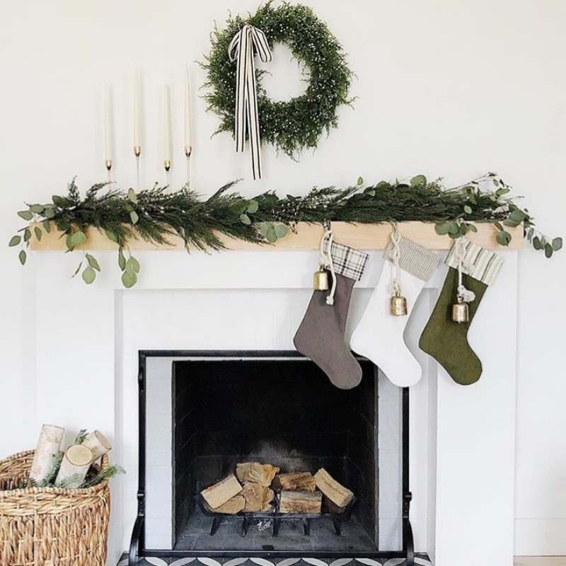 Minimalist Christmas Decorations by House Seven Design mantle decor with stockings and wreath