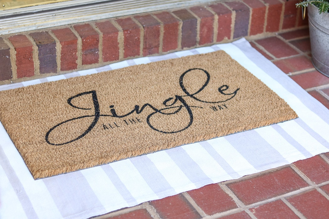 DIY rug using a drop cloth and chalk paint and layering a door mat ontop
