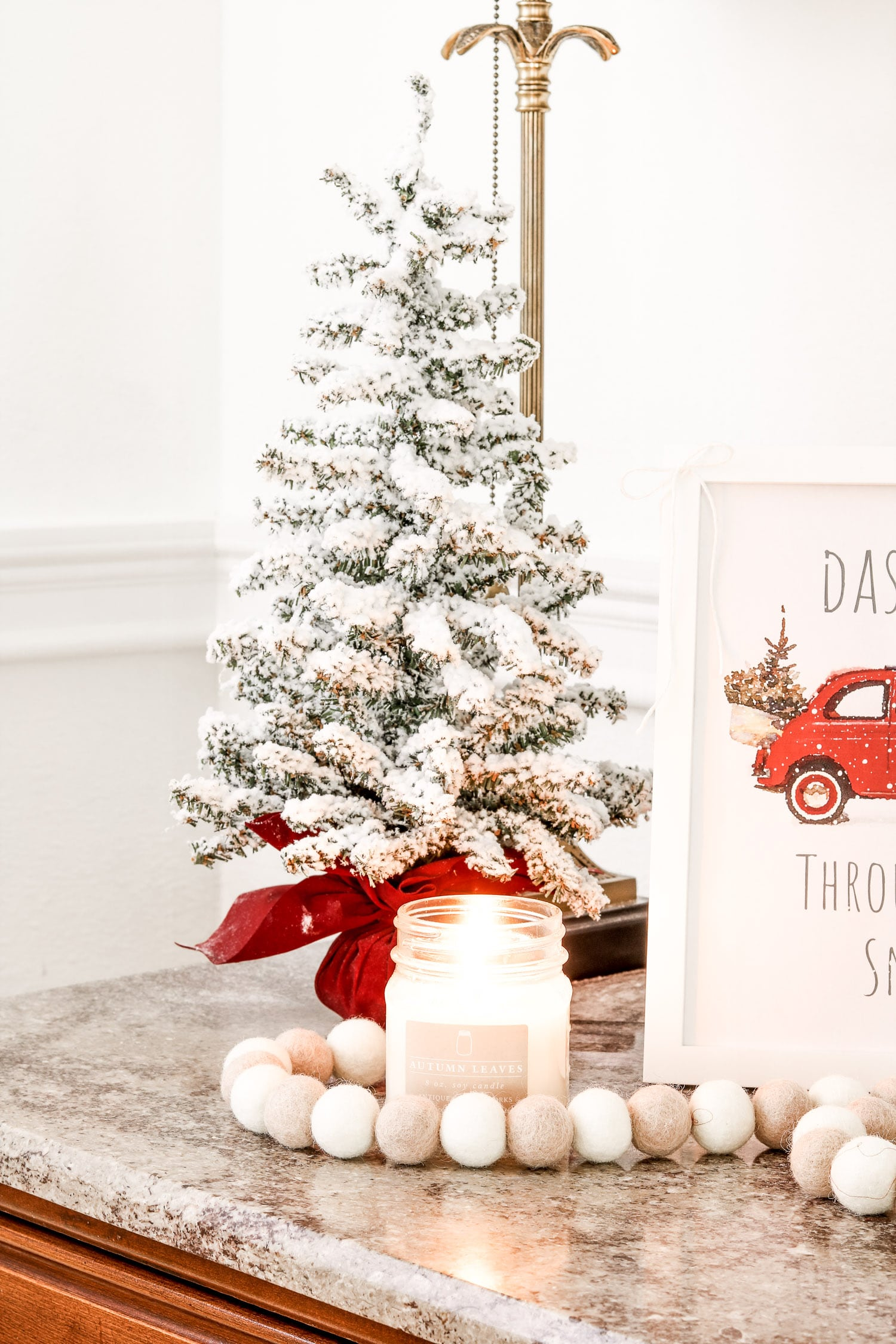 Christmas printable decor displayed with flocked tree, candle and felt beads