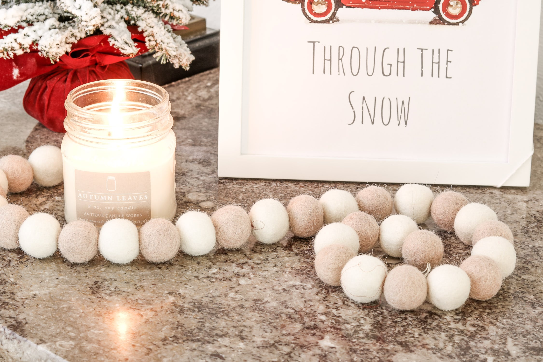 Christmas printable decor displayed with Antique Candle works candle and felt beads