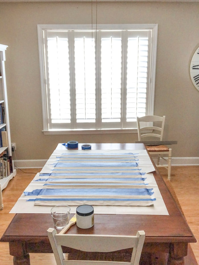 DIY rug using a drop cloth and chalk paint and painters tape