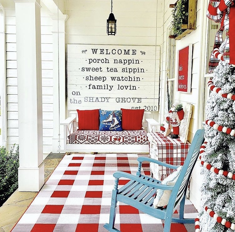 Christmas decorating ideas for porches by Life on the Shady Grove red buffalo check and red and white ball garland