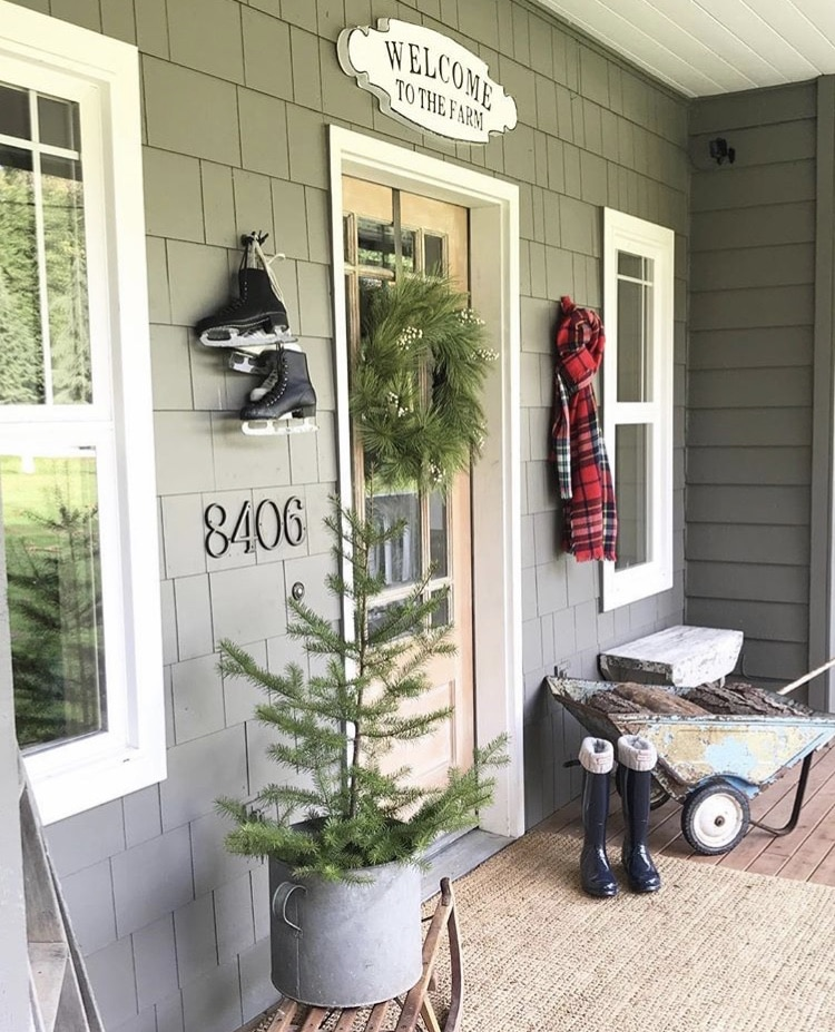 Christmas decorating ideas for porches by Little Farmstead mini tree in metal bucket with ice skates and scarf