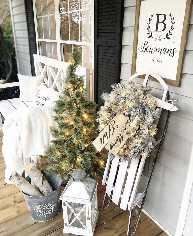 Christmas decorating ideas for porches by Distressed Bowman Nest Sled, Tree, Wreath, Lantern and Lights