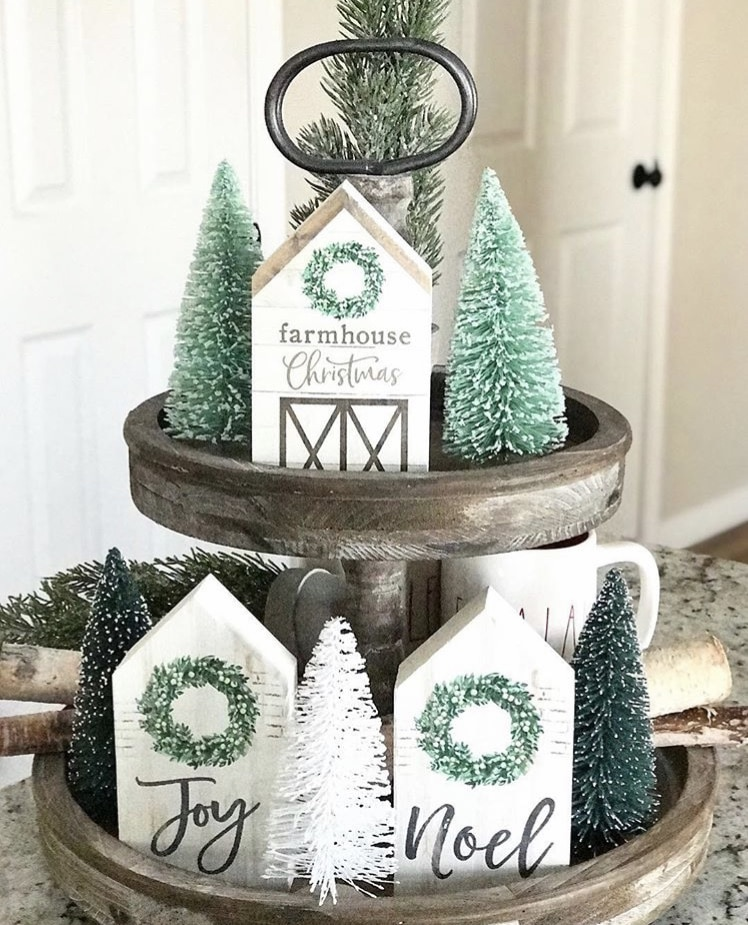 Christmas Farmhouse Tiered Tray by House on Wren with green bottle brush trees and mini wooden house signs
