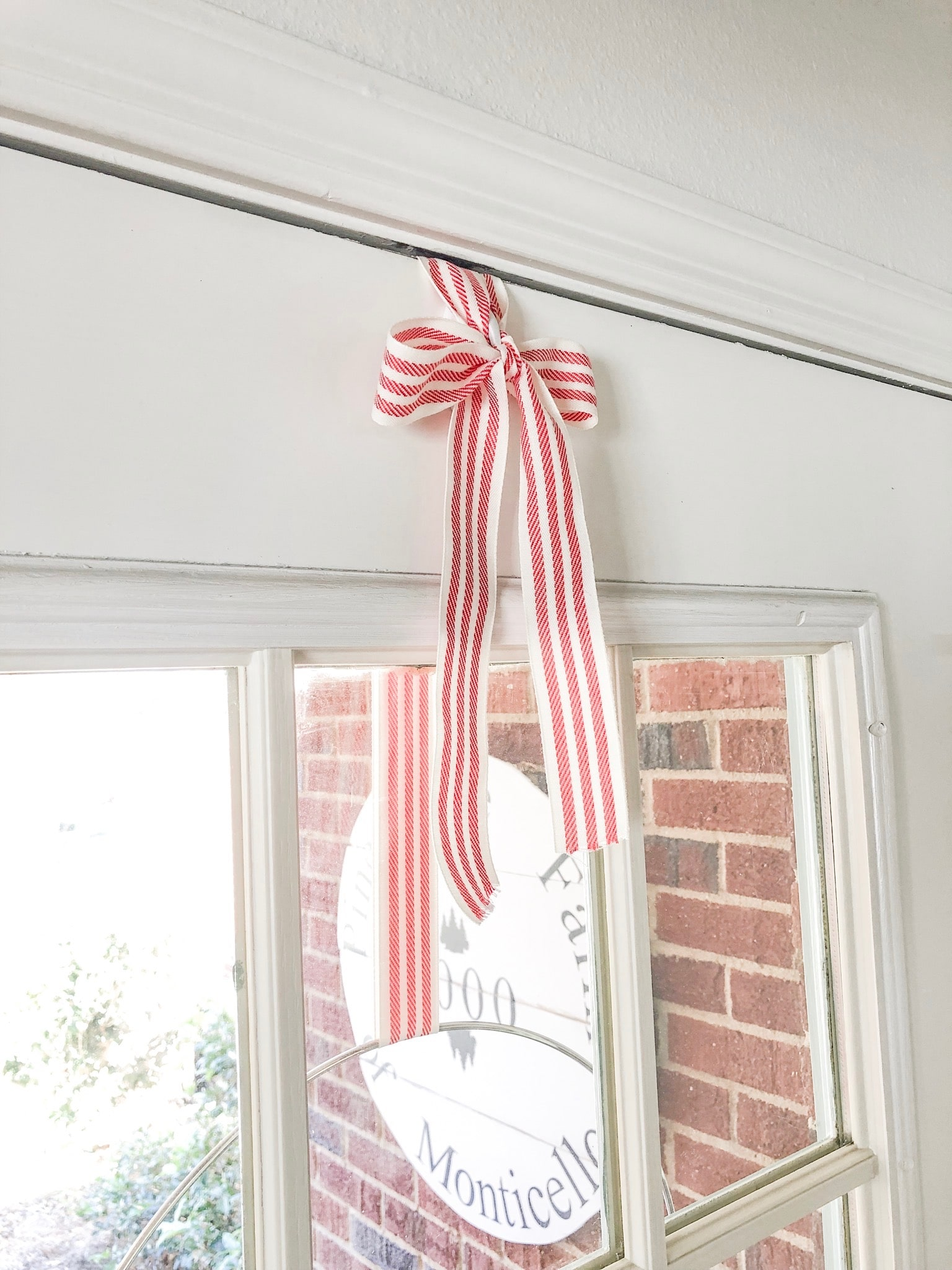 Christmas decorating ideas for front porches and how to hang a wreath with ribbon