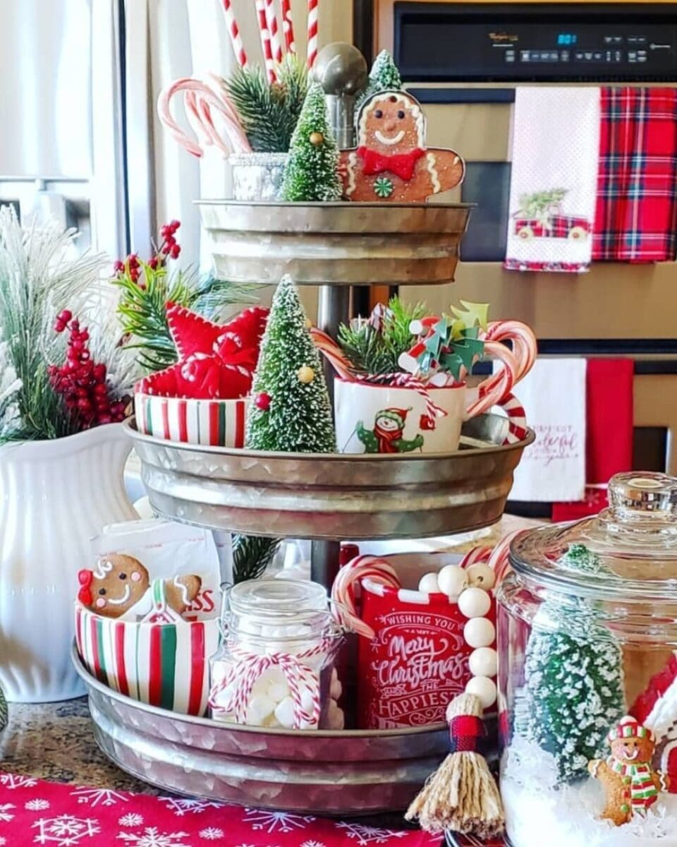 Galvanzied 3 tiered tray filled with red and green Christmas farmhouse decorations