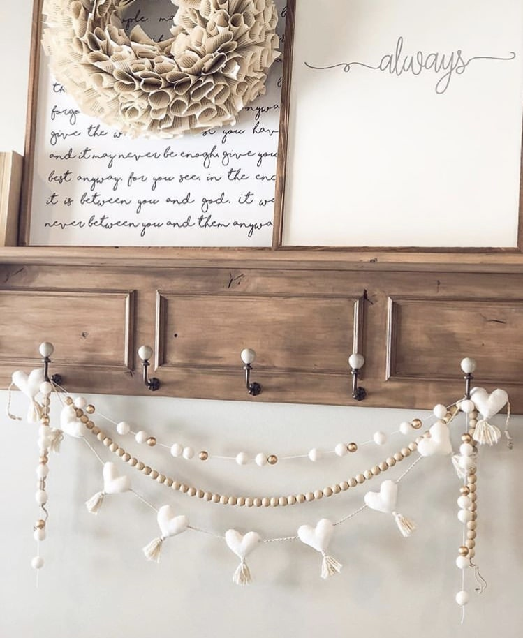 Valentine's Day Garland by Sweet Rose & Wren with three strands hung on a coat rack