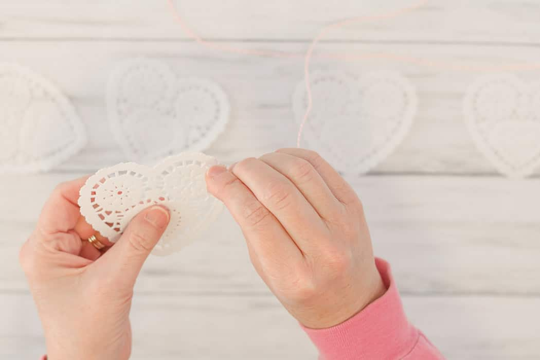 Valentine day doily heart garland threading twine