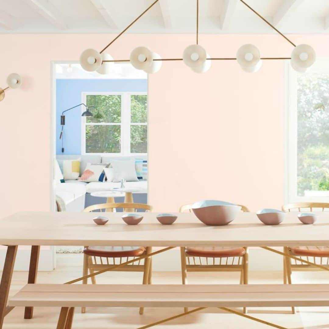 First Light 2102-70 is Benjamin Moore's color of the year for 2020 a pastel pink color that is displayed on dining area walls.