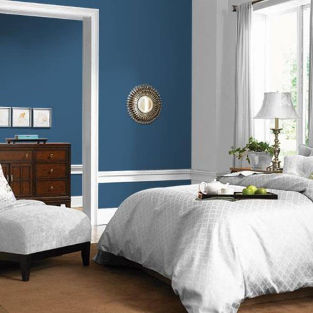 The color of the year for PPG is Chinese Porcelain PPG1160-6 painted on the walls of a bedroom
