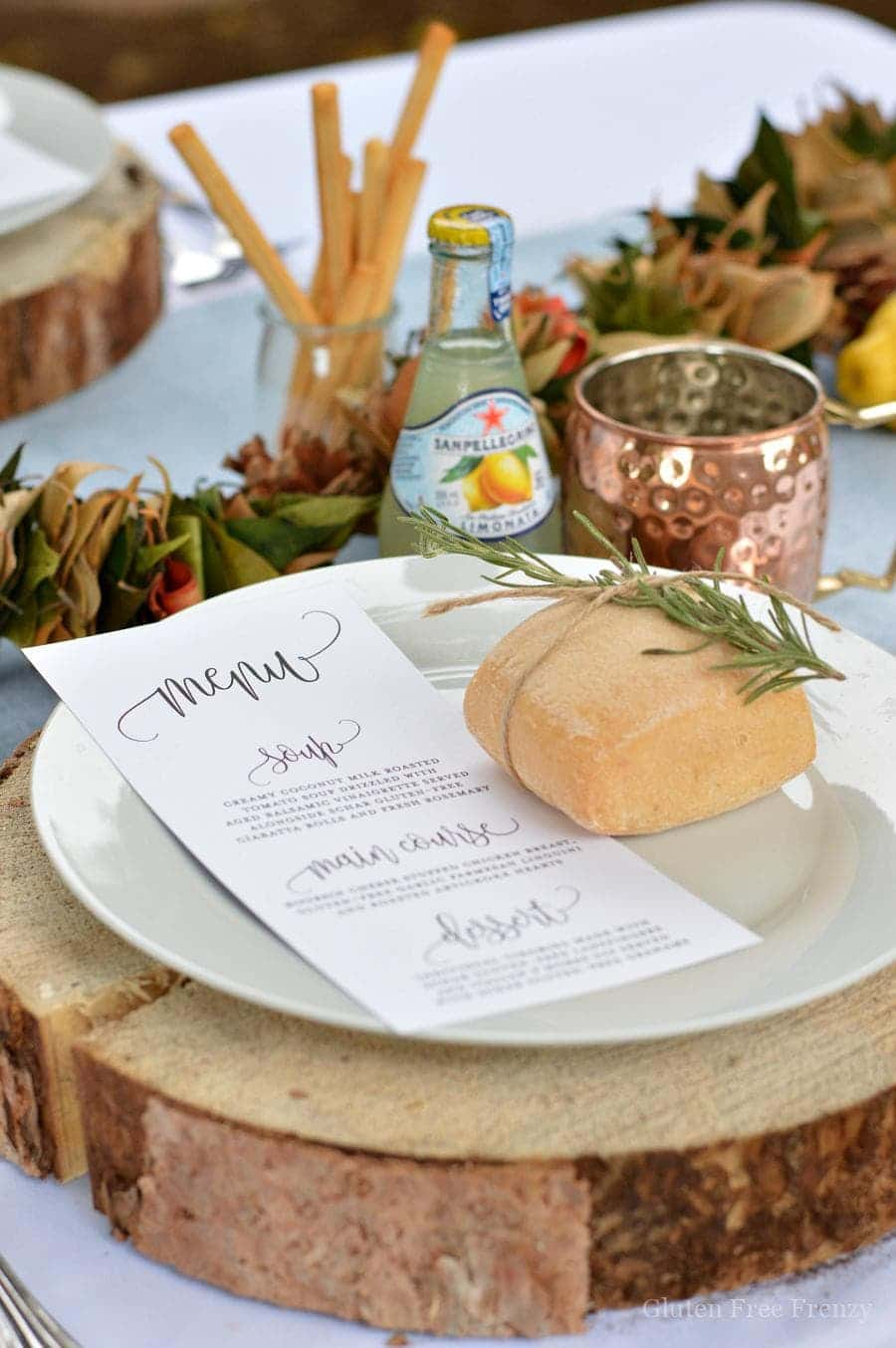 Italian Themed Dinner Party by This Vivacious Life with wood circle chargers and rosemary with a roll