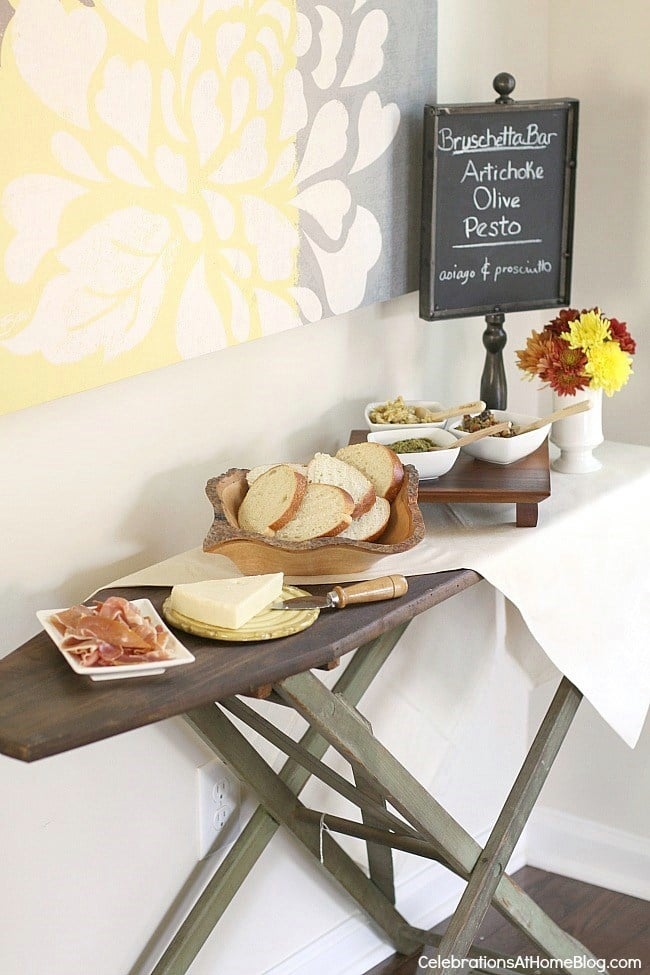 Italian Themed Dinner Party by Celebrations at Home with a antique ironing board with a bruschetta bar on top