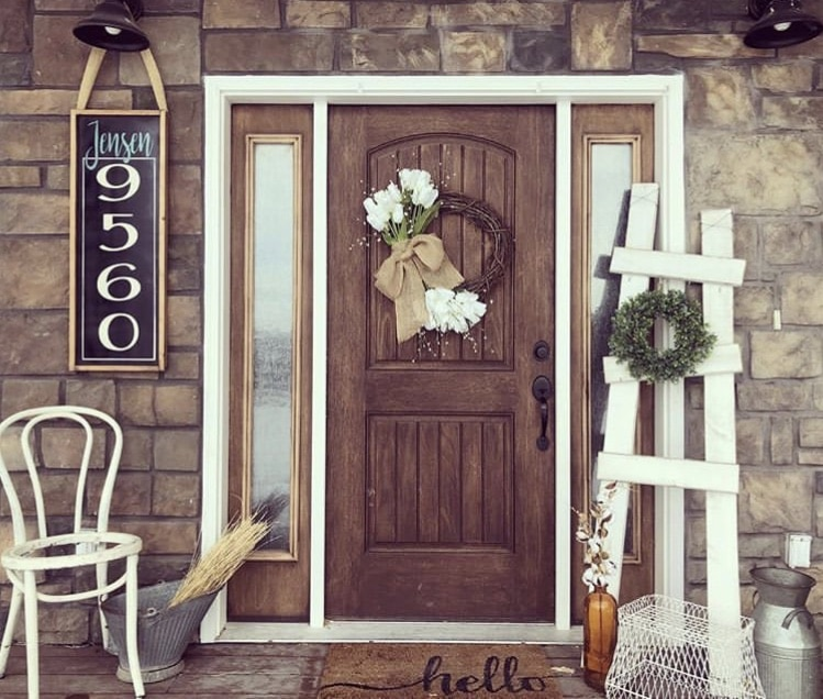 Front porch decorating ideas from Sawdust & Mascara Customs with rustic ladder and custom house numbers