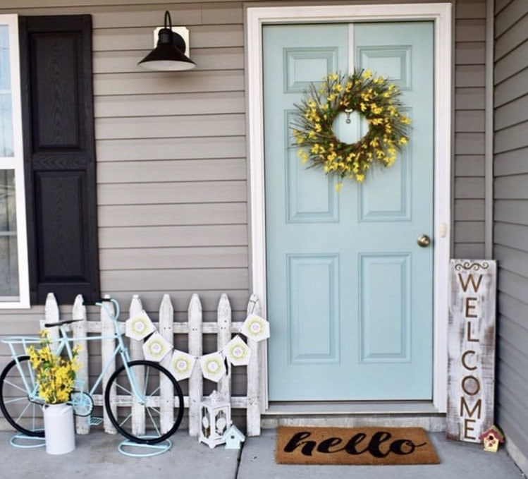 Front Porch Decorating Ideas by Shiplap Shanty with an aqua bicycle and yellow wreath