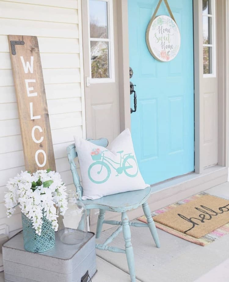 Front Porch Decorating Ideas by Featherbrained Fancy with white whisteria and a bicycle pillow