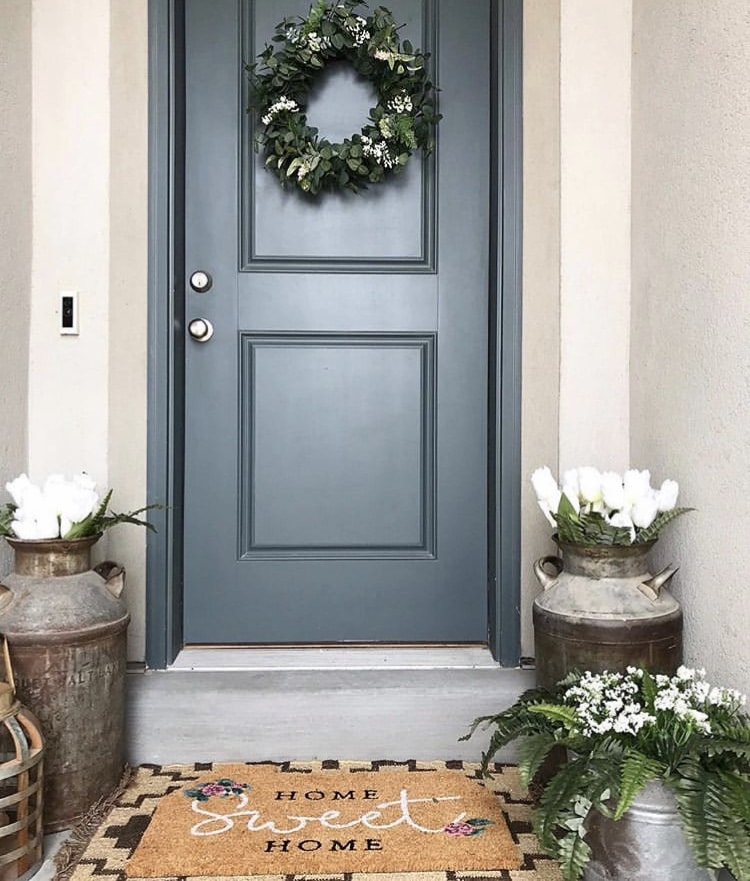 Decorating ideas for Down Mulberry Lane porch with white tulips and vintage jugs