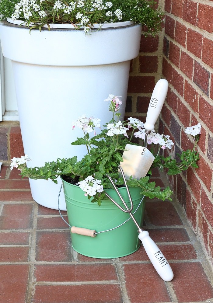 spring porch decorating ideas with plants, flower, Rae Dunn and pots