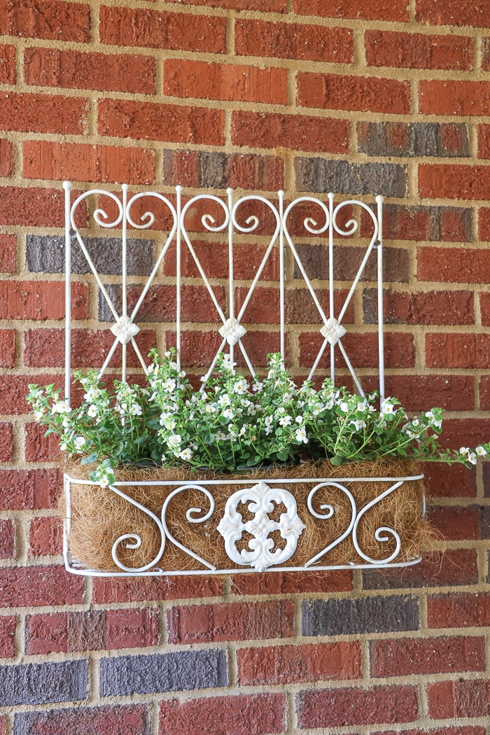 spring porch decorating ideas with iron wall flower box