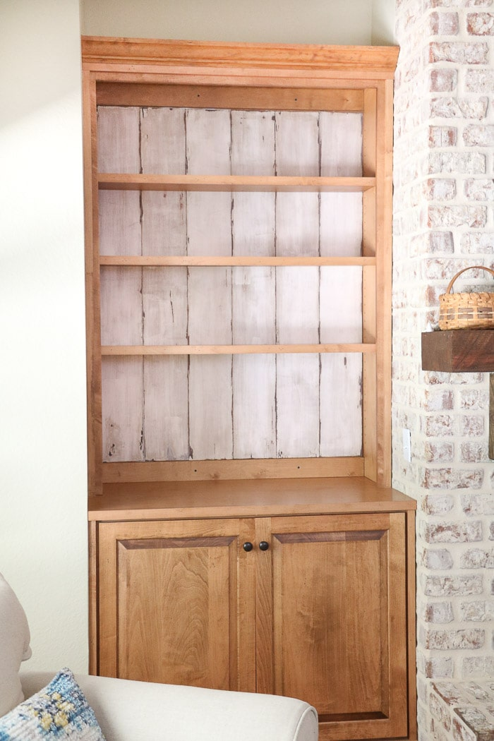 how to decorate a bookcase creating a rustic background