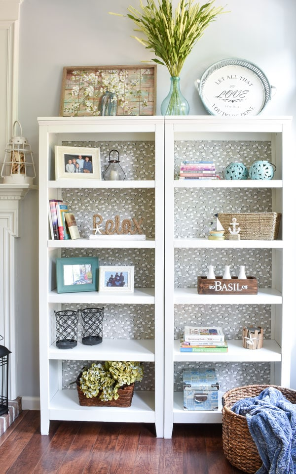 DIY Bookshelf Makeover by Heart Filled Spaces with a fabric backing bookshelf makeover