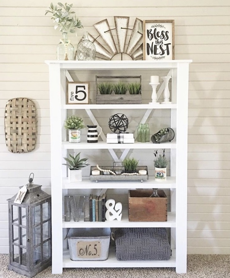 DIY Bookshelf Makeover by Farmhouse 165 with a freestanding bookshelf with pops of color allover