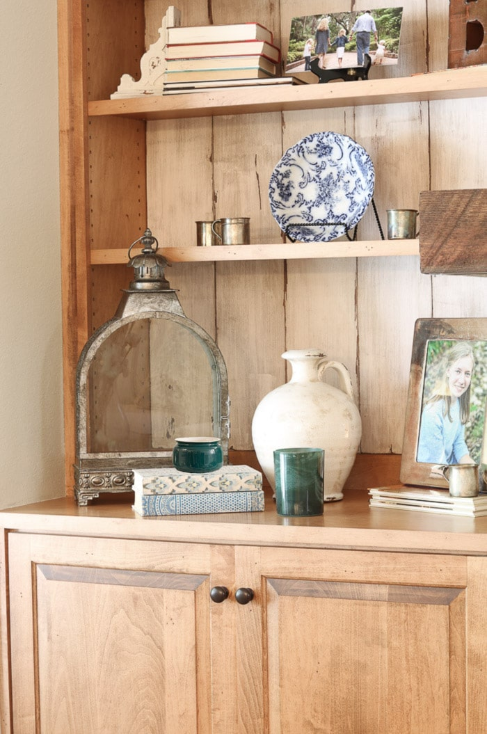 How to decorate a bookcase with large, small and medium size accessories.