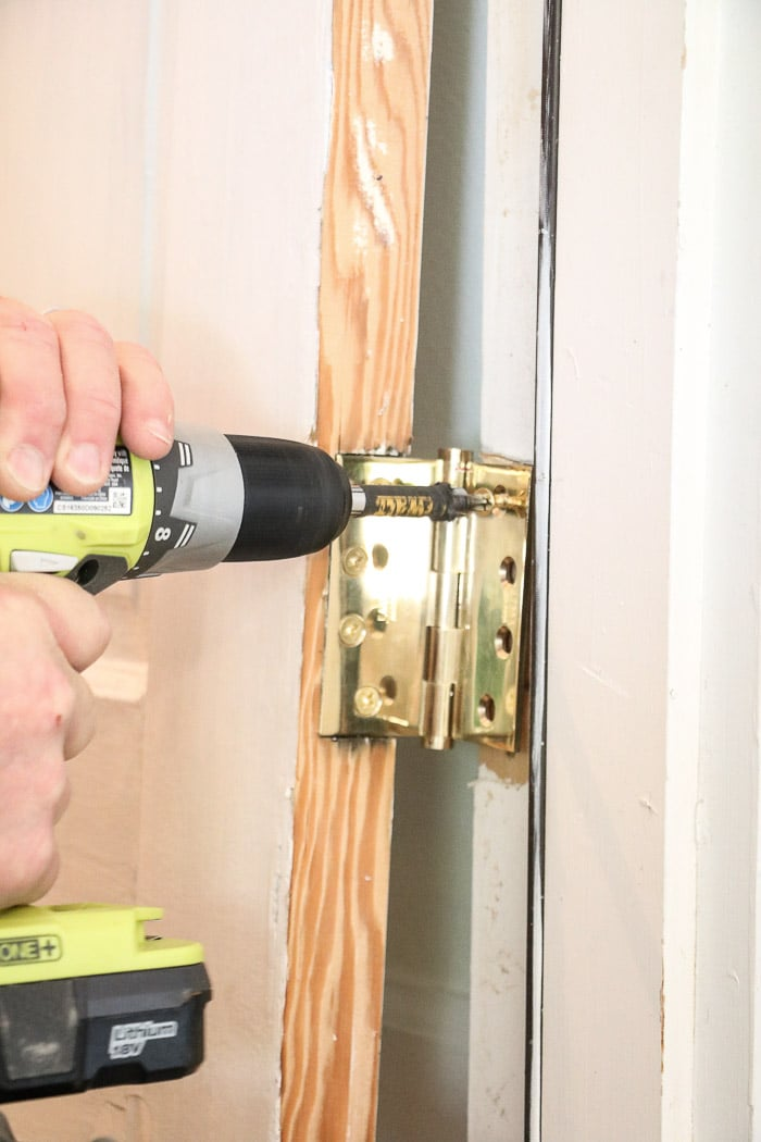 DIY exterior dutch door screwing in a door hinge