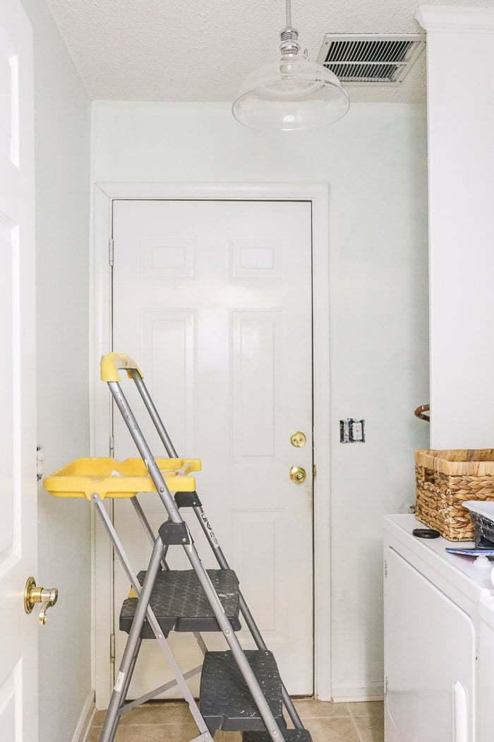 Small laundry room makeover using paint to transform a space.