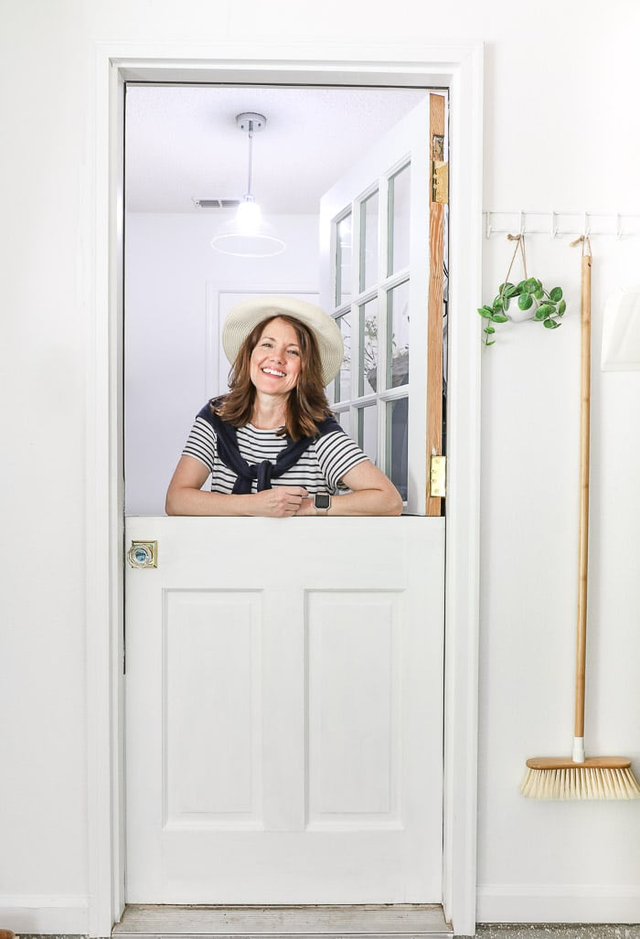 Small laundry room makeover using an old door made into a dutch door.