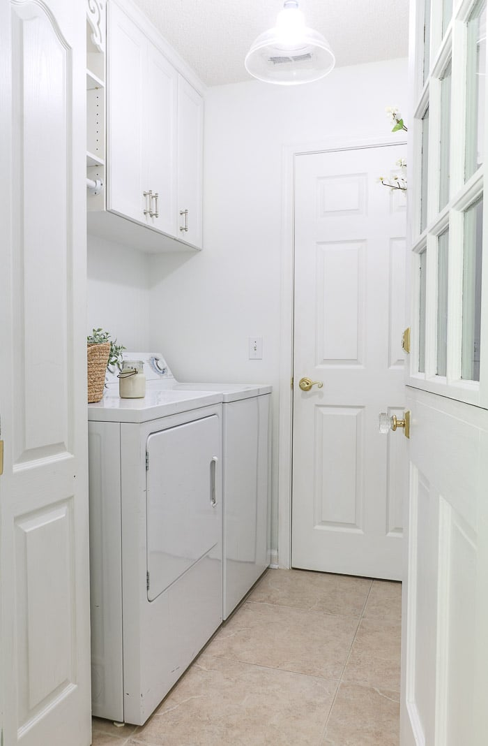 Small laundry room makeover using decorations, paint and a coat rack.