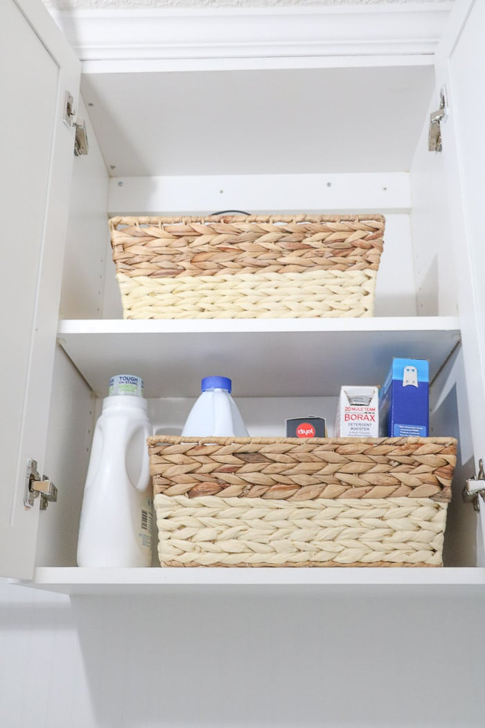 Small laundry room makeover using baskets to organize.