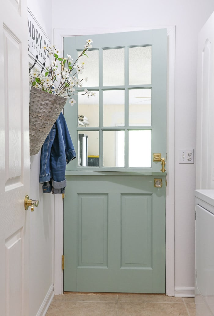 Small laundry room makeover using a dutch door to add style.