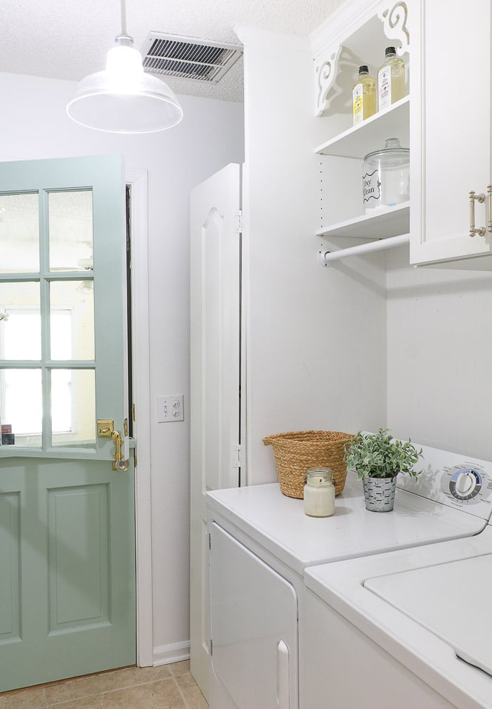 Small laundry room decor using a backsplash of beadboard