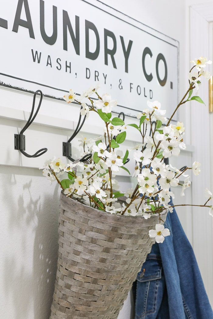 Small laundry room makeover creating a farmhouse style coat rack.