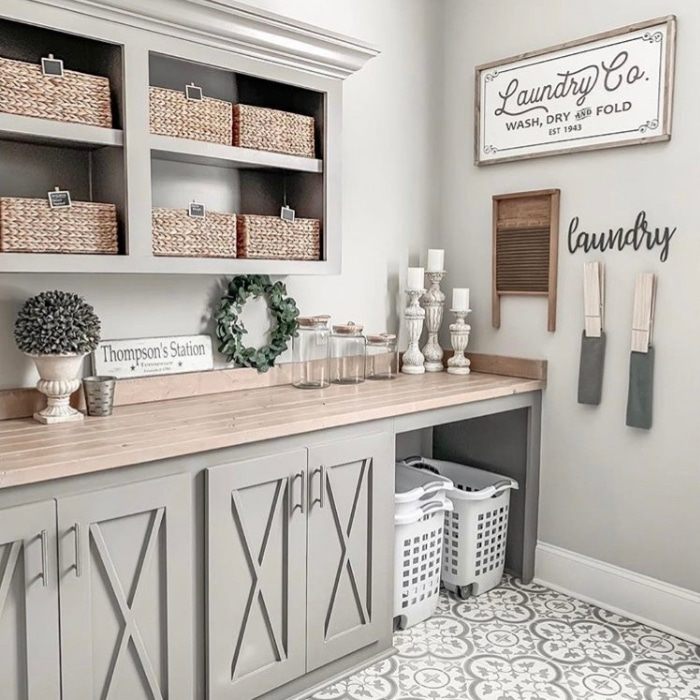 Farmhouse Laundry Room Decor by Jamie O'Dazier with large clothes pins and hyacinth baskets