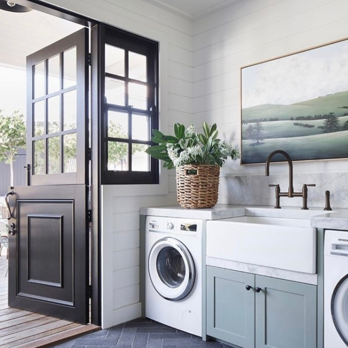 Farmhouse Laundry Room Decor by Kate Walker Design with a dutch door