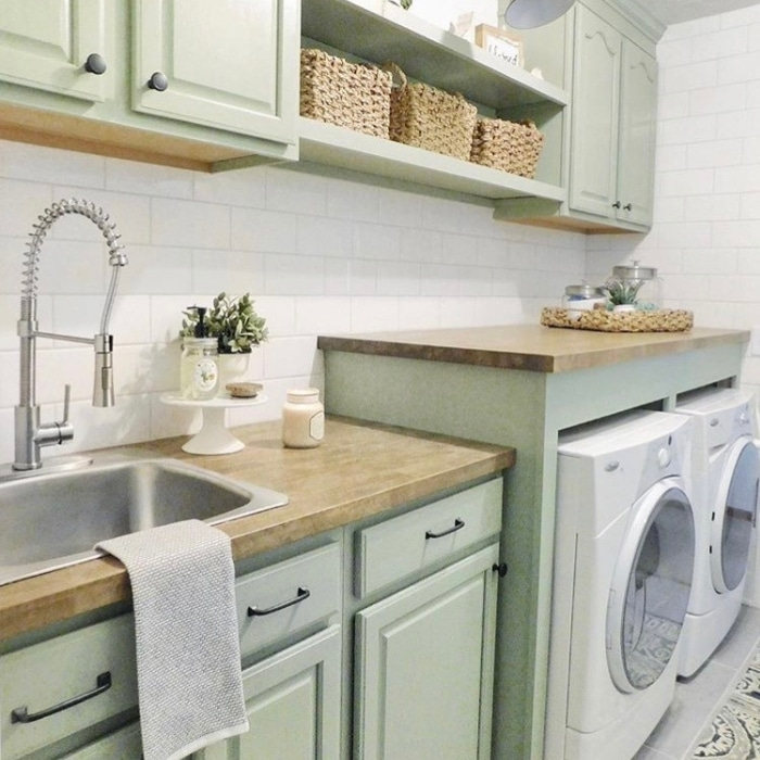 Farmhouse Laundry Room Decor by The Sycamore Farmhouse with mint green cabinetry and a sink