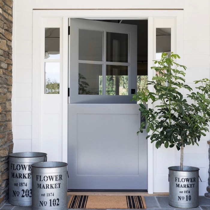 Modern Dutch Door Ideas by Studio McGee with a grey front door and flower market planters