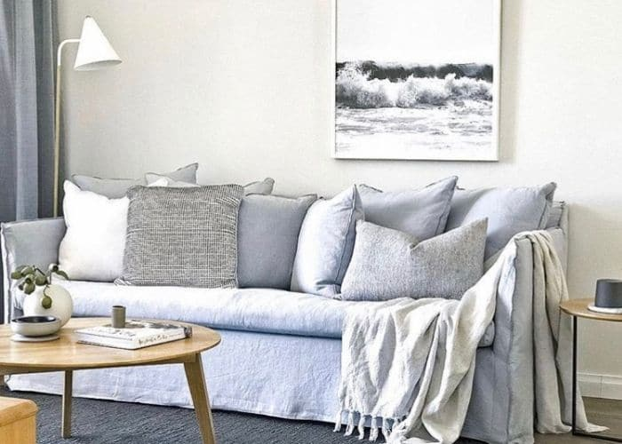 Slipcovered Sofa Ideas by The Hired Home with a light blue slipcovered sofa by Globe West