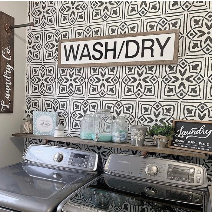 Farmhouse Laundry Room Decor by Bold Boundless Blonde with tiled walls and organized shelves