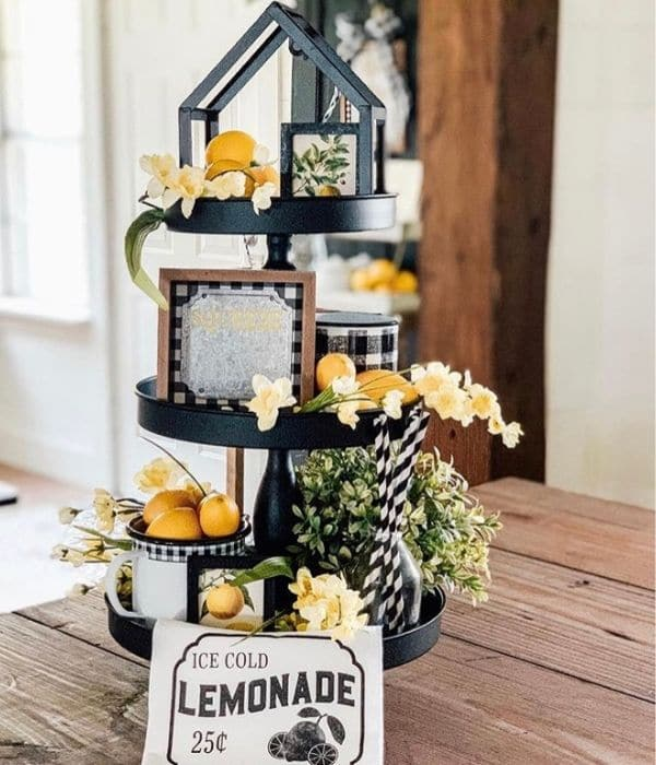 Lemon Décor by Returning Grace with a black tiered tray with a black, white and yellow themed tray