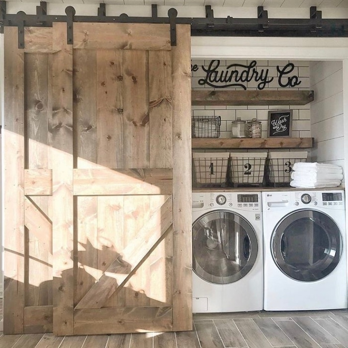 Farmhouse Laundry Room Decor by Fielderson Home with a sliding farm door and subway tiling