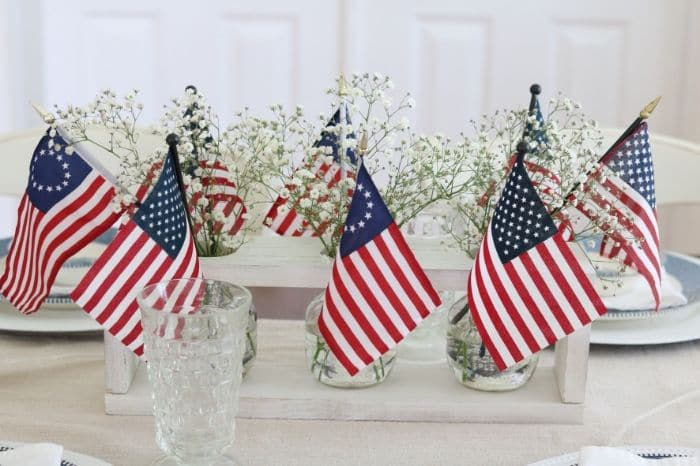 4th of July tablescape with Betsy Ross flags and babies breath