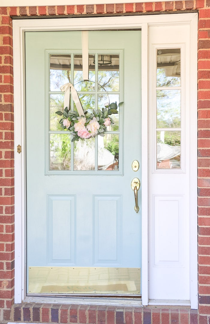 Best haint blue paint colors featuring Wythe Blue by Benjamin Moore on a front door porch