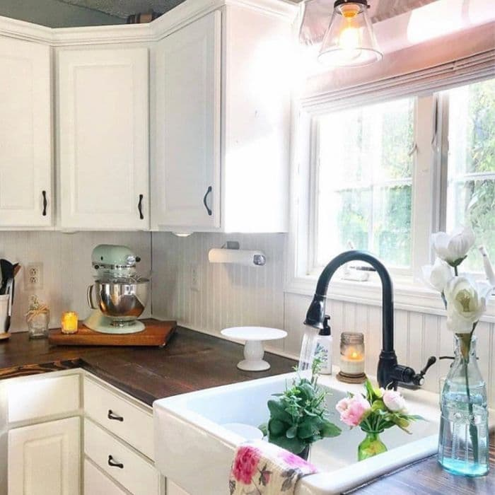 Farmhouse Backsplash by Ferns Nest with wainscot as the kitchen backsplash