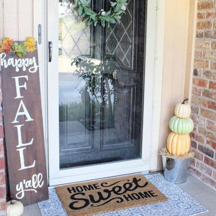 Layered Rug Ideas by The Painted Piano with a thankful fall doormat over a black and white buffalo check rug