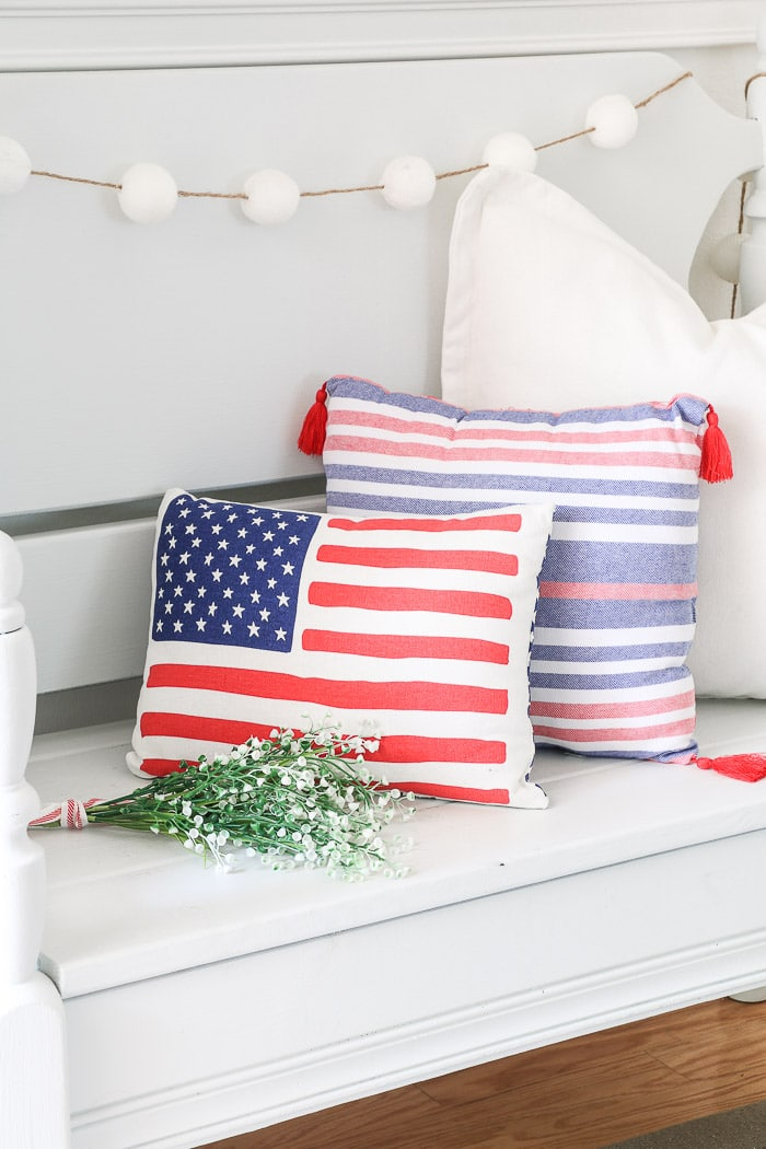 red, white and blue decorations in the entryway with American flag pillow