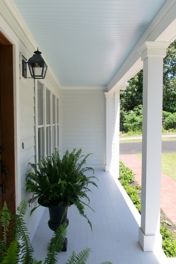 Best haint blue paint colors featuring Sea Salt by Sherwin Williams on a front door porch.  This porch is from the color concierge.